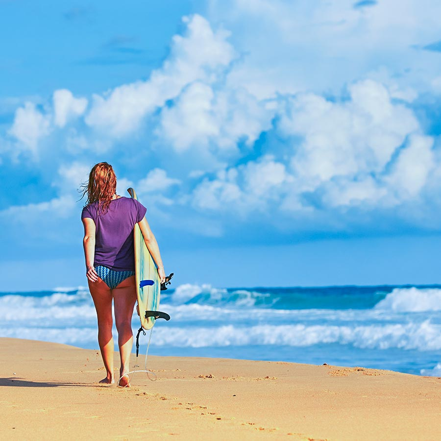 A Surfing Girl on the Beach