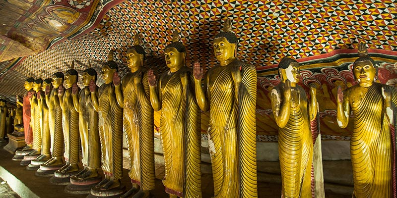 Numerous Buddha statues at Dambulla Rock Temple