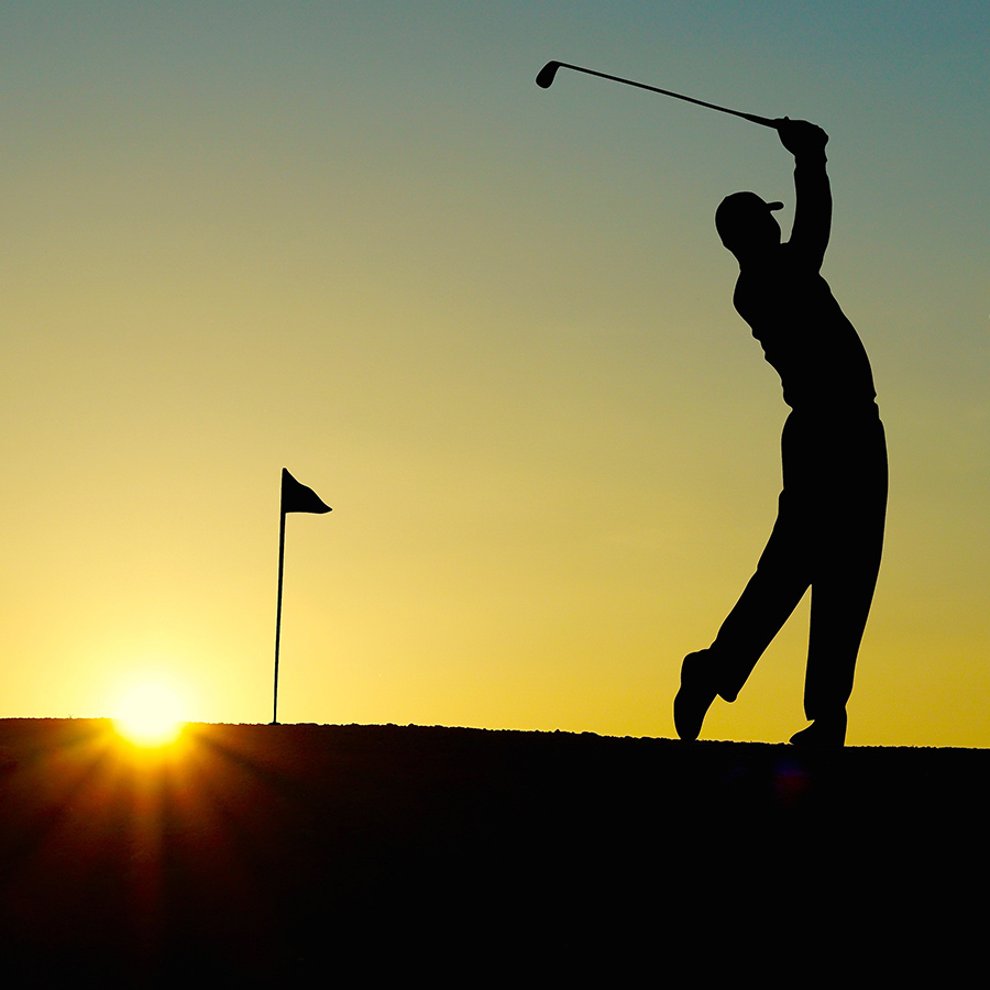 A Man Playing Golf In the Evening